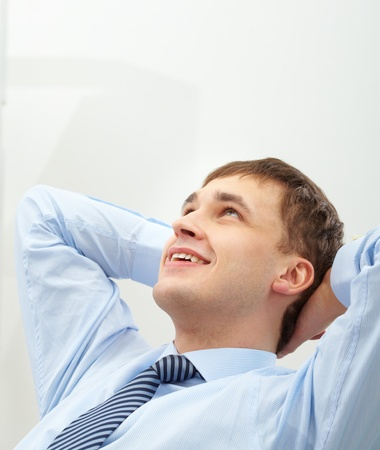 Photo of handsome businessman having short break photo