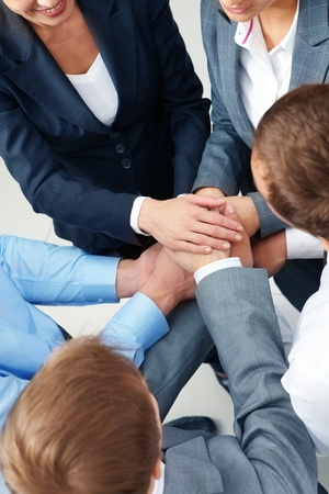 Image of business people keeping their hands in pile symbolizing support and power Stock Photo - 10799448