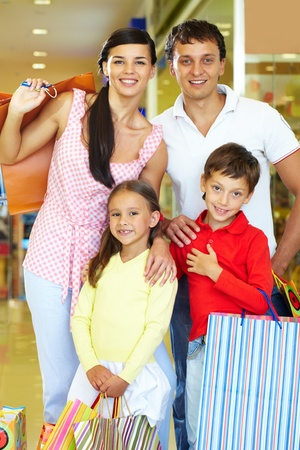 Portrait of happy parents and children during shopping photo