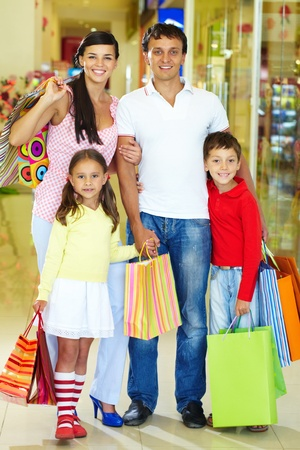 happy family shopping: Portrait of happy family during shopping