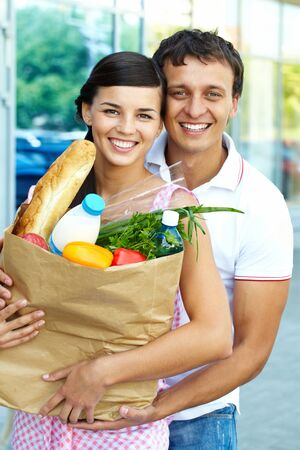 foodstuff: Portrait of a happy couple with foodstuff