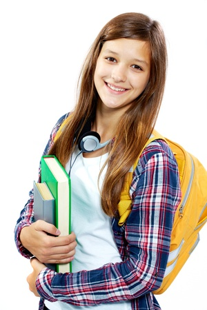 Cute girl with books smiling at camera in isolation photo