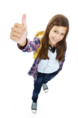 isolation: Cute girl with backpack showing thumb up and smiling at camera in isolation