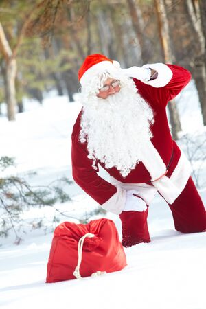 Santa Claus is lost in winter forest  Stock Photo - 10835227