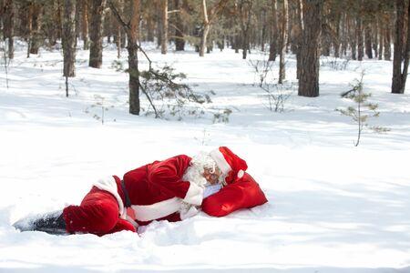 winter wood: Santa Claus sleeping in winter wood Stock Photo