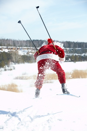 ski walking: Santa Claus rushing on skies