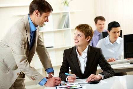 leadership training: Manger consulting his young employee