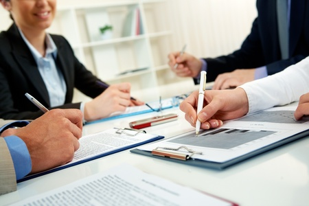 Human Resource: Businesspeople examining documents at their workplace