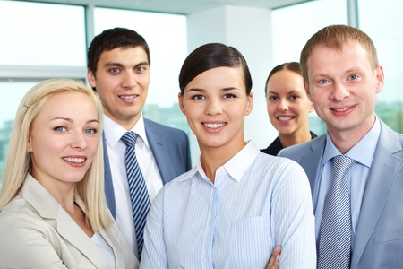Portrait of young business people looking at camera and smiling Stock Photo - 10864377