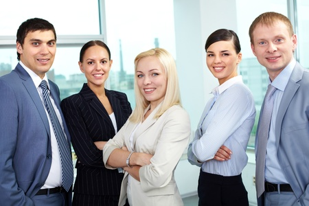 Portrait of five businesspeople looking at camera and smiling Stock Photo - 10864353