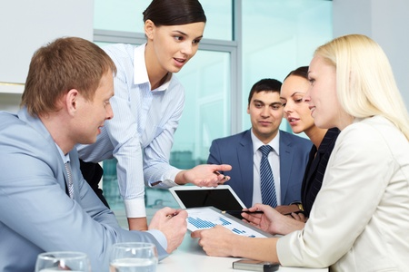 associates: Young businesswoman presenting her work Stock Photo