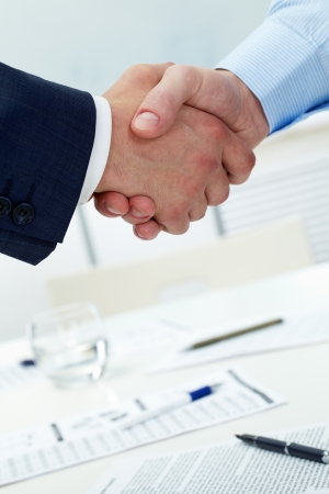 partnership power: Close-up of two shaking hands