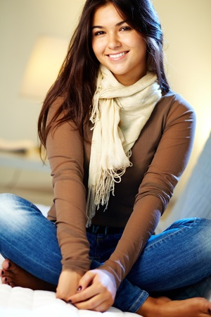 pretty teen girl: Portrait of young teenage girl looking at camera and smiling Stock Photo