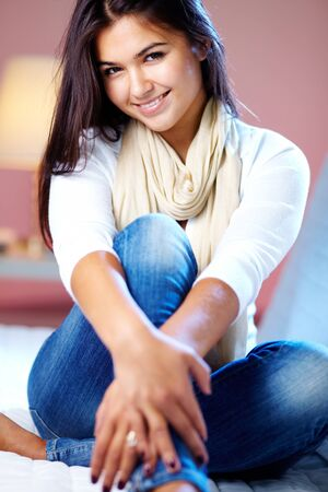 flirty: Portrait of young girl posing at camera at home
