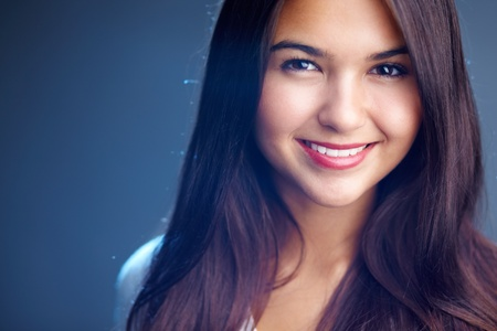 look latino: Portrait of young woman looking at camera Stock Photo