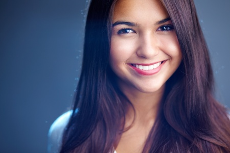 look latino: Portrait of young girl with perfect face and teeth  Stock Photo