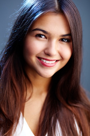 adolescents: Portrait of teenage girl with long brown hair