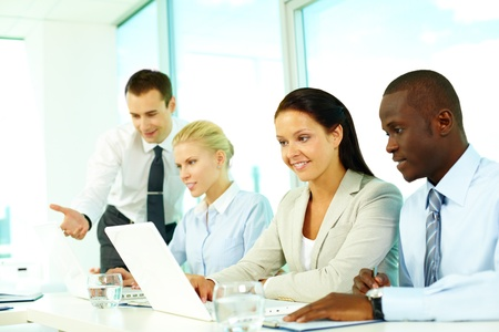 Young businesspeople communicating in office photo