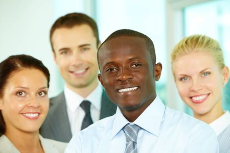 Young business team looking at camera and smiling Stock Photo - 10882292