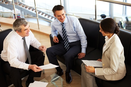 business consulting: Portrait of busy people discussing new working plan at meeting