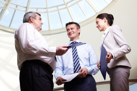 Portrait of three partners discussing ideas at meeting Stock Photo - 10931172