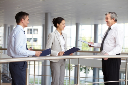 Portrait of busy people discussing new working plan or idea Stock Photo - 10944632