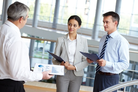 Portrait of busy people discussing new working plan or idea Stock Photo - 10931181