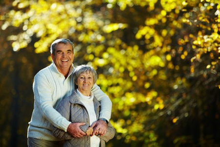 Photo of senior couple spending free time in autumn forest photo