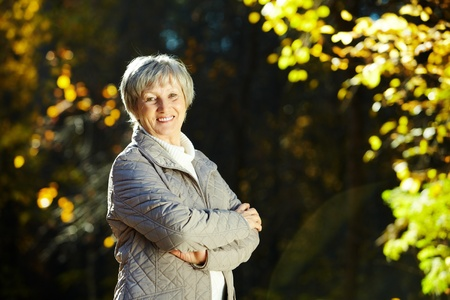 older women: Photo of senior woman in the park in autumn