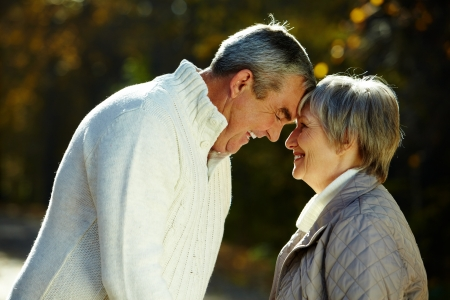 Photo of amorous senior couple in the park photo