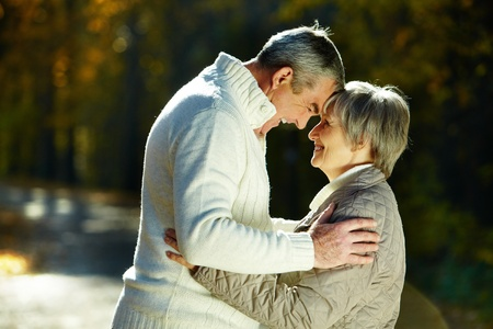 amorous woman: Photo of amorous aged man and woman in the park Stock Photo