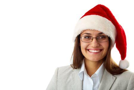 Portrait of happy businesswoman in Santa cap smiling at camera photo