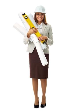 co worker: Portrait of elegant businesswoman in helmet holding rolled blueprints in isolation