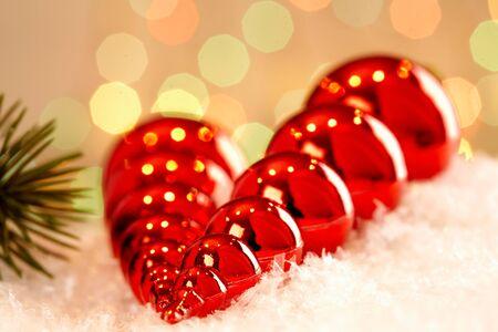 Red Christmas toys against glaring background photo