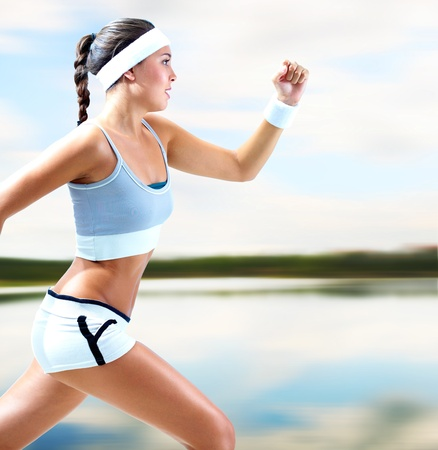 sports: Portrait of a girl running by the lake in summer