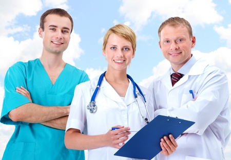 Portrait of friendly therapists standing in line and looking at camera with smiles Stock Photo - 10982440