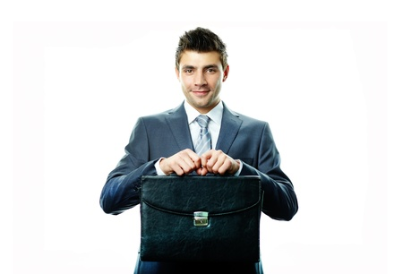 Portrait of attractive businessman with briefcase looking at camera photo