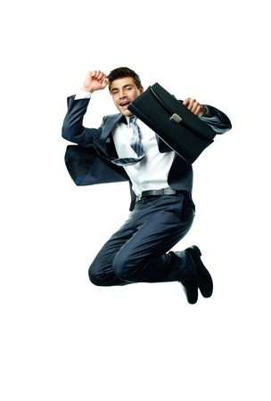 competitive business: Portrait of joyful businessman with briefcase jumping against white background