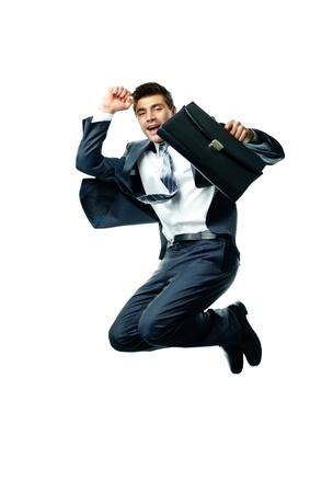 springende mensen: Portret van blije zakenman met aktetas springen tegen een witte achtergrond Stockfoto