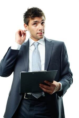 Portrait of businessman with clipboard thinking of idea photo