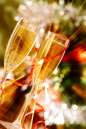 Two radiant champagne flutes on Christmas background   photo