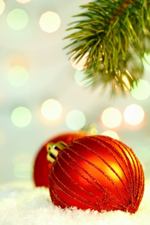 Red Christmas bauble against glaring background Stock Photo - 10988705
