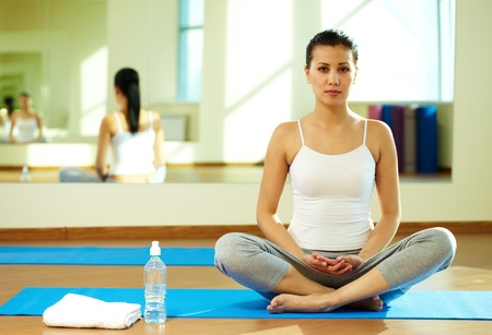 Portrait of serene girl practicing yoga in gym photo