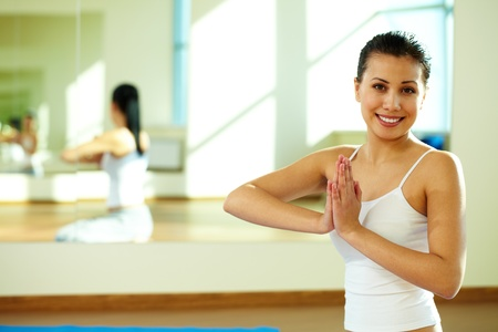 Portrait of happy girl during yoga practice in gym photo