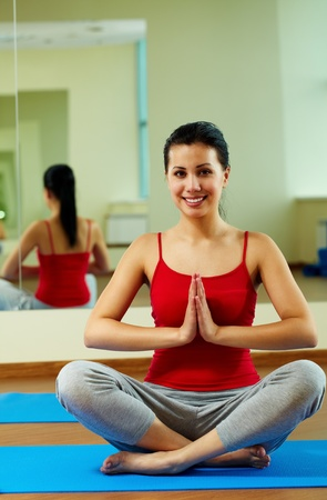 Portrait of happy girl meditating in gym Stock Photo - 11064203