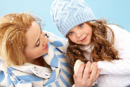 parental: Portrait of mother and her daughter in warm winter clothes Stock Photo