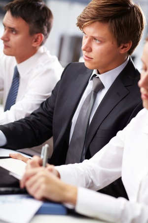 Image of young business people making notes at conference Stock Photo - 11064395