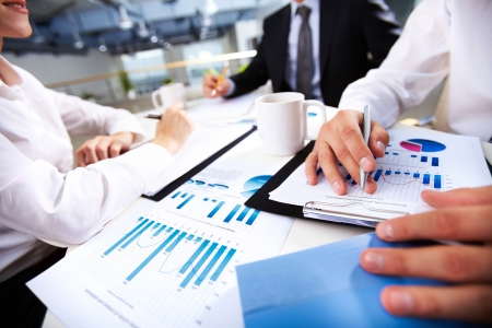 financial paperwork: Hands of business people over documents  Stock Photo