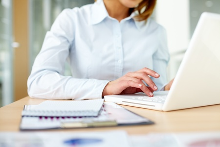 Image of female hands typing on keyboard in office   photo