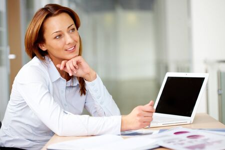 Portrait of smiling businesswoman at workplace  Stock Photo - 11109914